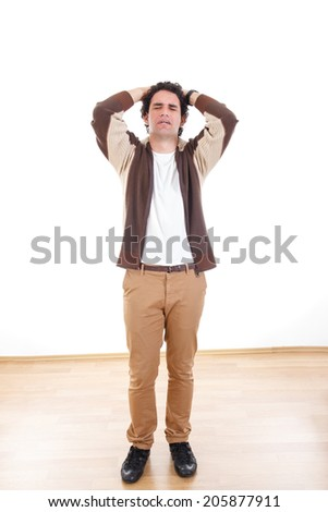Sad disappointed man with problems having stress holding head, Upset depressed young man expressing pain - stock photo