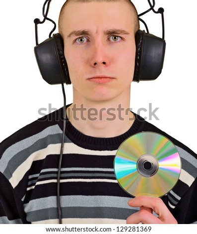 Sad disappointed teenager male music lover with big headphones and compact disk - stock photo