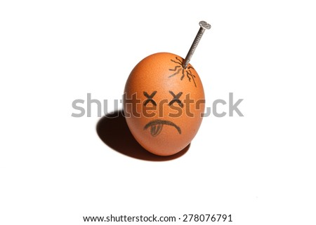Sad egg character with nail in in the head isolated over white background  - stock photo