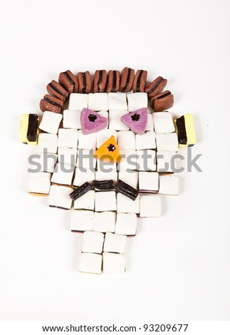 Sad face of an all-sorts man build with sweets - stock photo