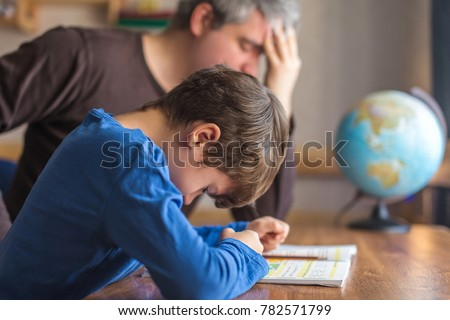 Sad father tired about sons failure on mathematics homework, stress