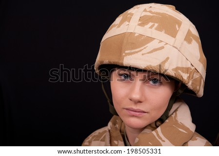 Sad Female British Soldier - stock photo