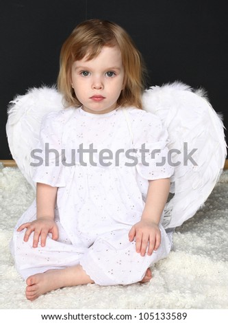 sad girl angel against a dark background