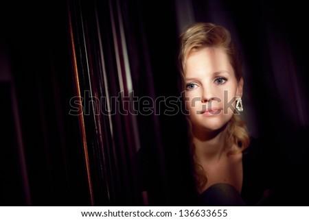 sad girl detras the curtains - stock photo