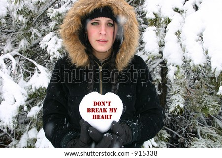 Sad Girl Holds Heart that says don't break my heart - stock photo