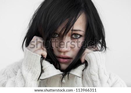 Sad girl in sweater. - stock photo