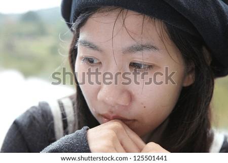 Sad girl looking away close up - stock photo
