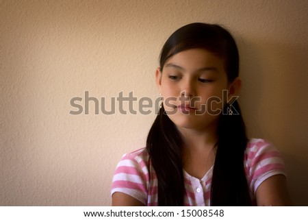 Sad girl looking to the side - stock photo