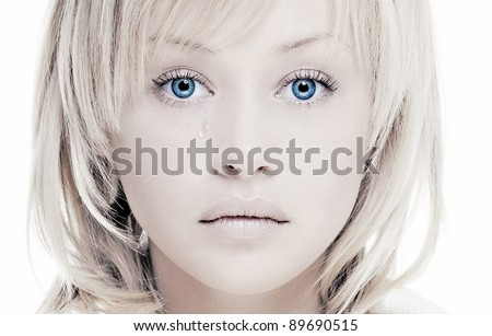 sad girl with a beautiful face and perfect skin tears - stock photo