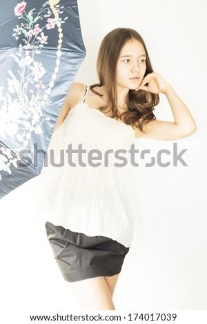 sad girl with a black umbrella - stock photo