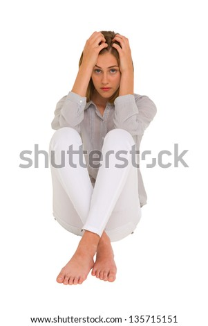 sad girl with hands on head - stock photo