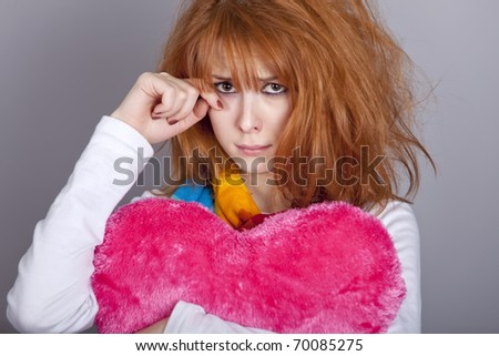 Sad girl with heart. St. Valentine Day - stock photo