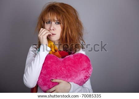 Sad girl with heart. St. Valentine Day