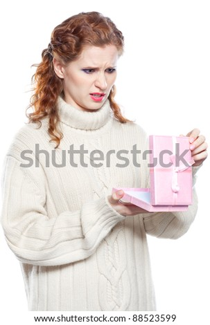 Sad girl with in cashmere sweater a gift isolated on white background