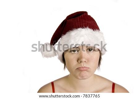Sad girl with Santa hat on white background - stock photo