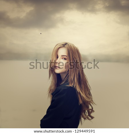 sad hipster girl outdoors - stock photo