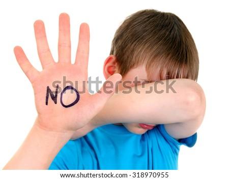 Sad Kid shows Stop Sign Gesture - stock photo