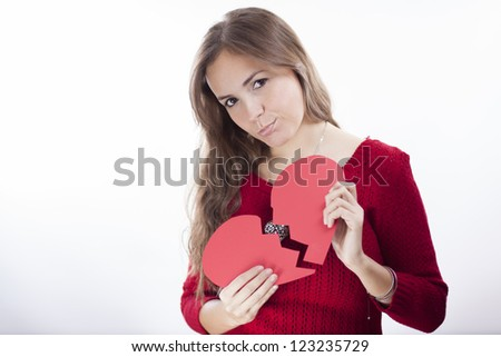 Sad latin young woman with a broken heart - stock photo