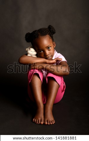 Sad little African girl - stock photo