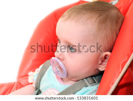 Sad Little Baby with pacifier - stock photo