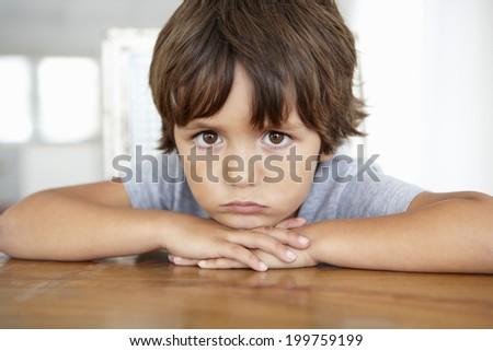 Sad little boy - stock photo