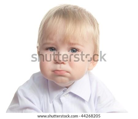 Sad little boy isolated on white - stock photo