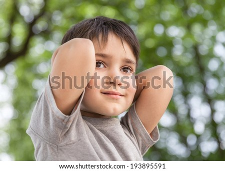 Sad little boy looking at something - stock photo