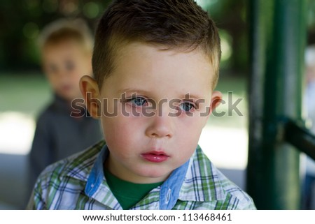 sad little boy with a runny nose - stock photo