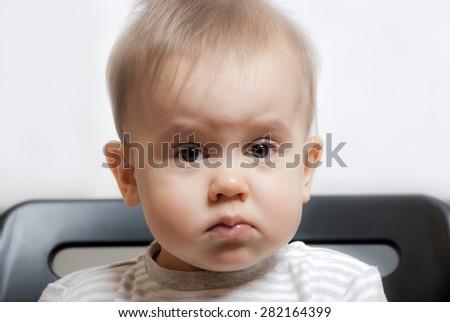 sad little boy 2 years old - stock photo