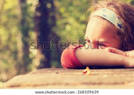Sad little girl. - stock photo