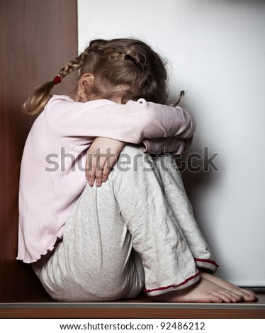 Sad little girl. Child's problems - stock photo