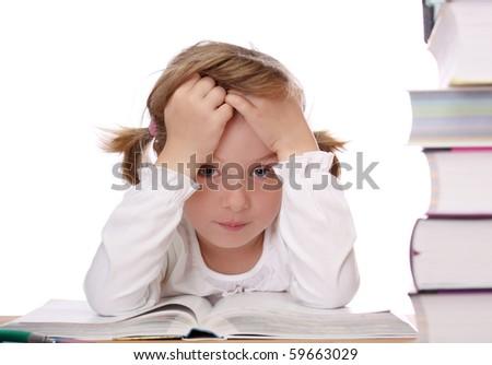 Sad little girl doing homework - stock photo