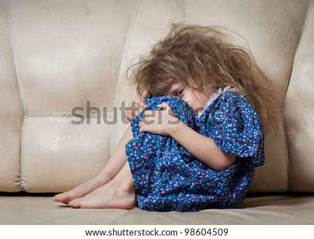 Sad little girl hides her face - stock photo