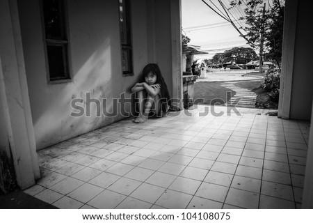 Sad little girl in black & white color - stock photo