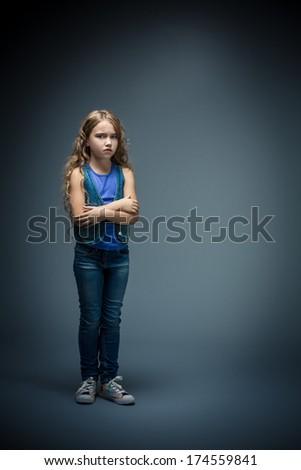 Sad little girl in studio - stock photo