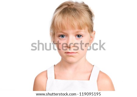 Sad little girl looking at camera with serious face isolated over white - stock photo