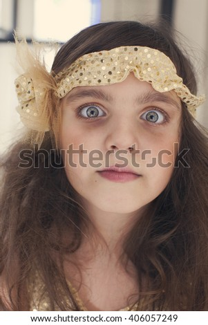 Sad little girl with eye circles - stock photo