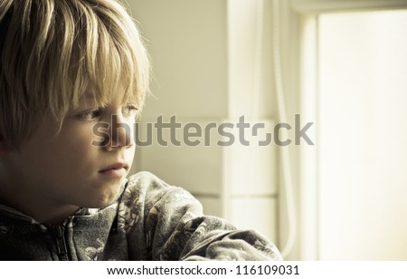 Sad lonely boy - stock photo