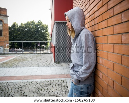 sad lonely girl in the city - stock photo