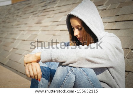sad lonely girl in urban city - stock photo
