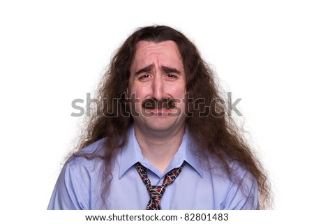 Sad long haired man crying with streaming tears 1 - stock photo