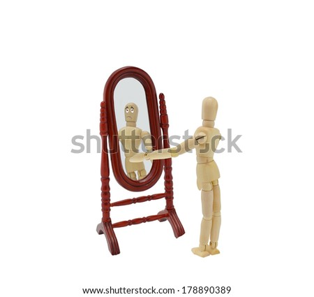 Sad looking in Mirror isolated on white background
