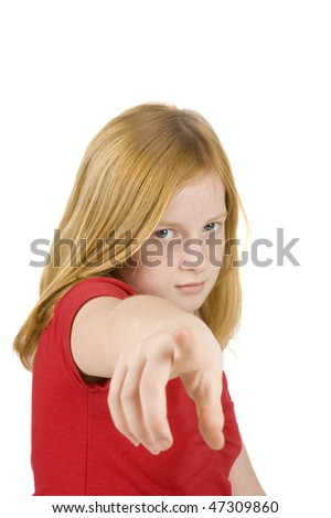 sad looking redhead girl is pointing at you isolated on white - stock photo