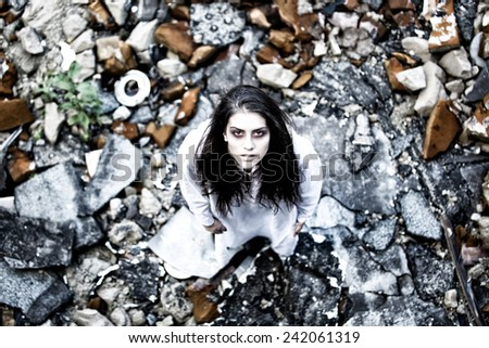 Sad lost schizophrenic anxious disoriented bipolar mentally ill brunette woman.concept of mental illness, stress,solitude,runaway from reality,stress caused mental problems.Depressed disoriented woman - stock photo