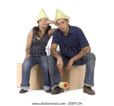 sad man and woman (workers) with paintbrush and roller - stock photo