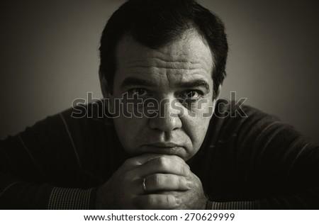 Sad man. Black and white photo. - stock photo