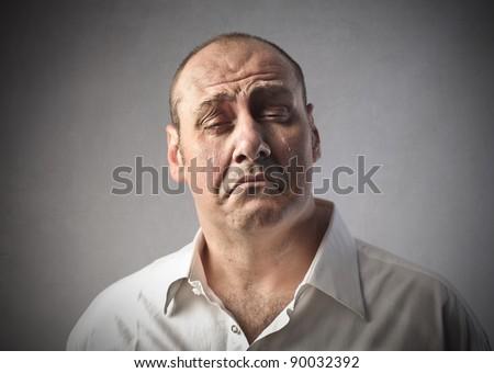 Sad man crying - stock photo