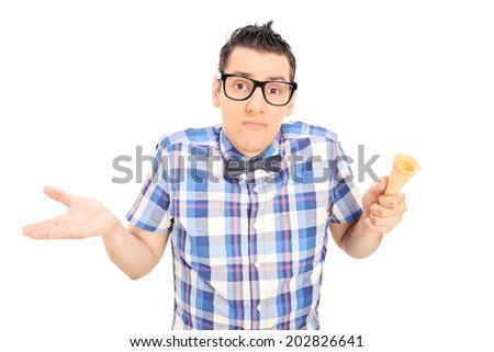Sad man holding an empty ice cream cone isolated on white background - stock photo