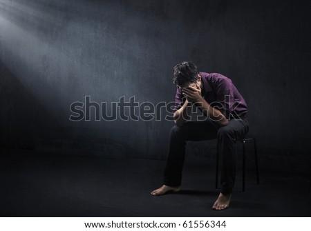 Sad man in a empty room - stock photo
