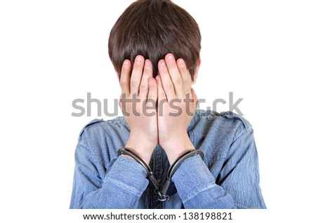 Sad Man in Handcuffs Hide his Face Isolated on the White Background
